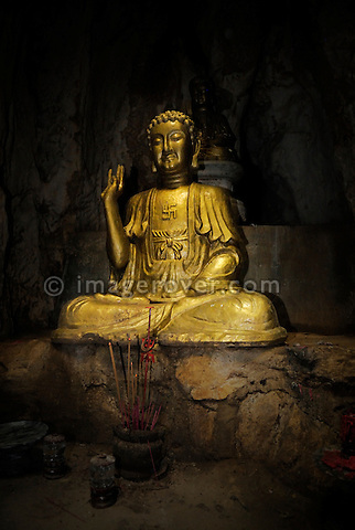 Asia, Vietnam, near Da Nang. In the sanctuary of Dong Tang Chon or Tang Chon cave within the famous buddhist sanctuaries at the Ngu Hanh Son or Marble Mountains.