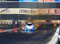 Feb 9, 2018; Pomona, CA, USA; NHRA funny car driver John Force prior to exploding the carbon fiber body off his car during qualifying for the Winternationals at Auto Club Raceway at Pomona. Force would walk away from the incident. Mandatory Credit: Mark J. Rebilas-USA TODAY Sports
