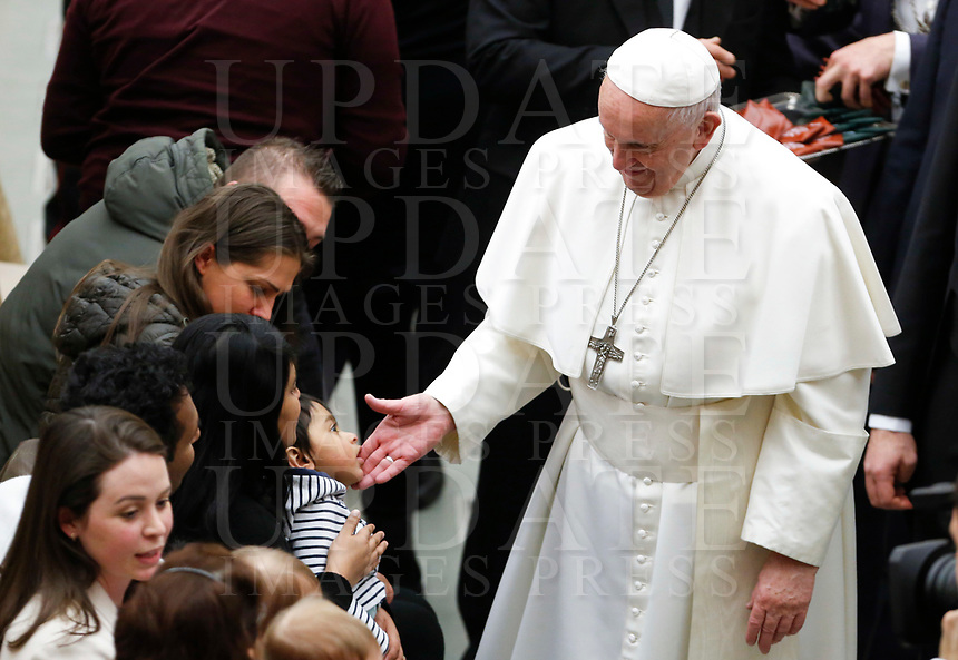 Pope Francis greets a child at the end of his weekly general audience in the Paul VI hall at the Vatican, January 22, 2020.<br /> <br /> UPDATE IMAGES PRESS/Riccardo De Luca<br /> <br /> STRICTLY ONLY FOR EDITORIAL USE