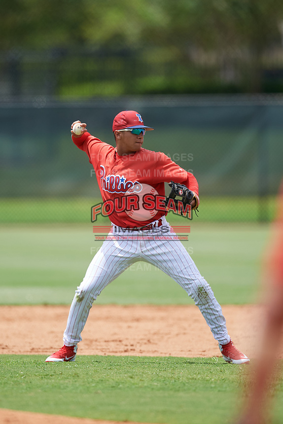 GCL Phillies East second baseman Nicolas Torres (18) throws to first base during a game against the GCL Blue Jays on August 10, 2018 at Carpenter Complex in Clearwater, Florida.  GCL Blue Jays defeated GCL Phillies East 8-3.  (Mike Janes/Four Seam Images)