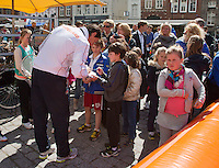 The Netherlands, Den Bosch, 16.04.2014. Fed Cup Netherlands-Japan, Street tennis on the market in the city center, captain Paul Haarhuis signing autographs<br /> Photo:Tennisimages/Henk Koster