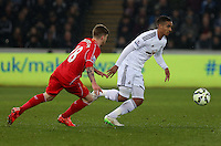 SWANSEA, WALES - MARCH 16: Kyle Naughton of Swansea (R) is follwed by Alberto Moreno (L) of Liverpool during the Premier League match between Swansea City and Liverpool at the Liberty Stadium on March 16, 2015 in Swansea, Wales