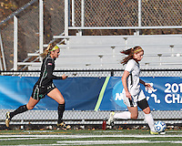 College of St Rose forward Laura Taylor (21) dribbles down the wing as Wilmington University defender Vikki Zipf (2) closes.. In 2012 NCAA Division II Women's Soccer Championship Tournament First Round, College of St Rose (white) defeated Wilmington University (black), 3-0, on Ronald J. Abdow Field at American International College on November 9, 2012.