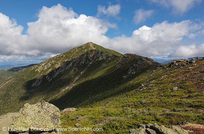 Mount Lincoln along Franconia Ridge from Little Haystack Mountain in the White Mountains, New Hampshire during the summer months. Hikers can be seen along the ridge on the right. And the Appalachian Trail travels across this open ridge.