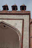 Agra, India.  Jama Masjid (Friday Mosque), built 1648.  Chhatris (domed pavilions) line the roof.  Persian calligraphy in Arabic Script.