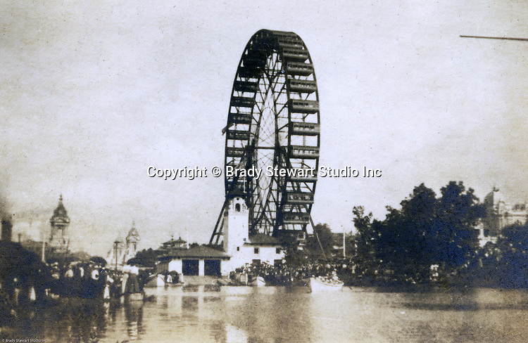 Client: St Louis World's Fair<br /> Product:  Ferris Wheel<br /> Manufacturer: GWG Ferris Company and Bethlehem Irons Works in Pittsburgh<br /> <br /> St Louis MO:  A view of the spectacular Ferris Wheel along with the very long lines to get on it.  Brady Stewart spent a lot of time on the Wheel photographing the park.