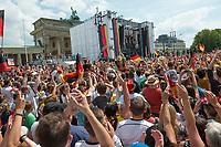 Begruessung der deutschen Fussball Nationalmannschaft nach deren WM-Erfolg vor dem Brandenburger Tor.<br /> Berlin, 15.07.2014<br /> <br /> English: Welcome party for the German national team in Berlin at Brandenburg gate (fanmile), after winning the FIFA Soccer World Cup 2014 in Brazil, celebrating the world champions, July 15, 2014, Germany