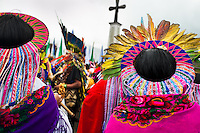 """Natives from the Kamentsá tribe, wearing colorful feather headgears, participate in the Catholic mass during the Carnival of Forgiveness, a traditional indigenous celebration in Sibundoy, Colombia, 12 February 2013. Clestrinye (""""Carnaval del Perdón"""") is a ritual ceremony kept for centuries in the Valley of Sibundoy in Putumayo (the Amazonian department of Colombia), a home to two closely allied indigenous groups, the Inga and Kamentsá. Although the festival has indigenous origins, the Catholic religion elements have been introduced and merged with the shamanistic tradition. Celebrating annually the collaboration, peace and unity between tribes, they believe that anyone who offended anyone may ask for forgiveness this day and all of them should grant pardons."""