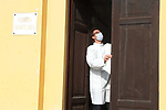 Europe Virus Outbreak - Cemetery Works in Pergine Valsugana, Italy on April 21, 2020. A sweeping lockdown is in place in Italy to try to slow down the spread of coronavirus pandemic. Employees wearing mask close the door of a mortuary room.