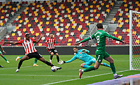 Brentford's Ethan Pinnock clears a cross from Preston North End's Alan Browne<br /> <br /> Photographer Stephanie Meek/CameraSport<br /> <br /> The EFL Sky Bet Championship - Brentford v Preston North End - Sunday 4th October 2020 - Griffin Park - Brentford<br /> <br /> World Copyright © 2020 CameraSport. All rights reserved. 43 Linden Ave. Countesthorpe. Leicester. England. LE8 5PG - Tel: +44 (0) 116 277 4147 - admin@camerasport.com - www.camerasport.com