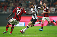 Calcio, Serie A: Milan vs Juventus, Milano, stadio San Siro, 20 settembre 2014.<br /> Juventus midfielder Claudio Marchisio is challenged by AC Milan defender Cristian Zapata, left, during the Italian Serie A football match between AC Milan and Juventus at Milan's San Siro stadium, 20 September 2014.<br /> UPDATE IMAGES PRESS/Isabella Bonotto