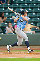 Dennis Raben (32) of the Wilmington Blue Rocks follows through on his swing against the Winston-Salem Dash at BB&T Ballpark on August 3, 2013 in Winston-Salem, North Carolina.  The Blue Rocks defeated the Dash 4-2.  (Brian Westerholt/Four Seam Images)
