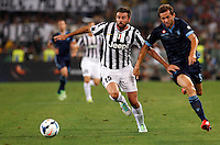 Calcio, Supercoppa di Lega: Juventus vs Lazio. Roma, stadio Olimpico, 18 agosto 2013<br /> Juventus defender Andrea Barzagli, left, is challenged by Lazio midfielder Senad Lulic, of Bosnia, during the Italian League Supercup football final match between Juventus and Lazio, at Rome's Olympic stadium,  18 August 2013.<br /> UPDATE IMAGES PRESS/Riccardo De Luca