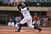 Greenville Astros right fielder Ydarqui Marte #12 swings at a pitch during a game against the Pulaski Mariners at Pioneer Park July 12, 2014 in Greenville, Tennessee. The Mariners defeated the Astros 11-10. (Tony Farlow/Four Seam Images)