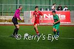 Referee John Ross keeps an eye on play as Kerrys Tom Whittleton closes down Mark O'Mahoney of Cork in the U17 EA Sports soccer League