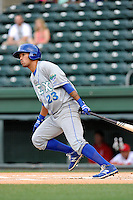 Shortstop Humberto Arteaga (23) of the Lexington Legends bats in a game against the Greenville Drive on Tuesday, April 14, 2015, at Fluor Field at the West End in Greenville, South Carolina. Lexington won, 5-3. (Tom Priddy/Four Seam Images)