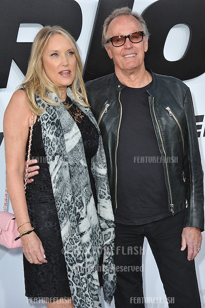 """Peter Fonda & wife Parky Fonda at the world premiere of """"Furious 7"""" at the TCL Chinese Theatre, Hollywood.<br /> April 1, 2015  Los Angeles, CA<br /> Picture: Paul Smith / Featureflash"""