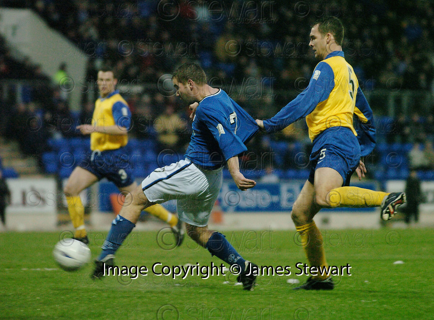 20/12/03          Copyright Pic : James Stewart.File Name : stewart06-stjohn_v_qos.PETER MACDONALD IS PULLED BACK BY BRIAN REID..... .Payment should be made to :-.James Stewart Photo Agency, 19 Carronlea Drive, Falkirk. FK2 8DN      Vat Reg No. 607 6932 25.Office     : +44 (0)1324 570906     .Mobile  : +44 (0)7721 416997.Fax         :  +44 (0)1324 570906.E-mail  :  jim@jspa.co.uk.If you require further information then contact Jim Stewart on any of the numbers above.........