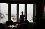 MUMBAI, INDIA - SEPTEMBER 27, 2010: The Sea Lounge in the heritage wing at the renovated Taj Mahal Palace and Tower Hotel in Mumbai. The Hotel has re-opened after the terror attacks of 2008 destroyed much of the heritage wing. The wing has been renovated and the hotel is once again the shining jewel of Mumbai. pic Graham Crouch