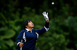 Vivian Lee of Hong Kong throws her ball during the Hyundai China Ladies Open 2014 on December 12 2014 at Mission Hills Shenzhen, in Shenzhen, China. Photo by Li Man Yuen / Power Sport Images