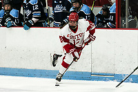 BOSTON, MA - JANUARY 04: Kaleigh Donnelly #12 of Boston University brings the puck forward during a game between University of Maine and Boston University at Walter Brown Arena on January 04, 2020 in Boston, Massachusetts.