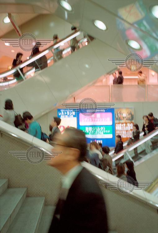 Escalators at a shopping mall.