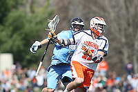 University of Virginia men's lacrosse player George Huguely (11) plays against John Hopkins March 27, 2010 at Klockner Stadium in Charlottesville, VA.  George Huguely, 22, a fourth-year student from Chevy Chase, Md., has been charged with first-degree murder in the death of UVa women's lacrosse player Yeardley Love, 22, a fourth-year student from Cockeysville, Md., that took place early Monday morning May 3, 2010 in Charlottesville, Va. Photo/Andrew Shurtleff