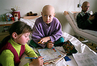 "Belarus/Weissrussland, 2005/03/19<br /> MINSK. Alexei (9) has intestine cancer. The town where he was born is situated 80 km from Minsk and like other regions it is highly contaminated through radioactive fallout from Chernobyl. ""It is difficult to judge whether Alexei got cancer because of Chernobyl or not. But we have a lot of patients from the contaminated areas,"" says his doctor Ismail Zade from the Belarussian pediatric center for oncology and hematology in Minsk. Alexei's younger sister Valery comes with her grandmother to visit her brother every week. The family is poor. The grandmother is retired but she still works to help the family. Her salary is about 75,000 Belorussian rubles per month, which is less than 40 US dollars.<br /> ? Vaclav Vasku/EST&OST"