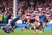 9th October 2021; Kingsholm Stadium, Gloucester, England; Gallagher Premiership Rugby, Gloucester versus Sale Sharks;  Adam Hastings of Gloucester hands off Curtis Langdon of Sale Sharks
