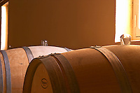 Two barriques barrels in the wine cellar with a traditional glass stopper. Good to use if there is still some slow fermentation going on - Chateau Haut Bergeron, Sauternes, Bordeaux