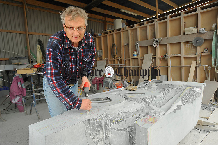 Jan Merkwiecz at work on the sculpture of Brian Boru in Tuamgraney. Photograph by John Kelly.