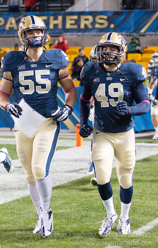 Pitt defensive players Luke Maclean (55) and Nico Elms (49) take the field. The Pitt Panthers defeated the Old Dominion Monarchs 35-24 at Heinz Field, Pittsburgh, Pennsylvania on October 19, 2013.