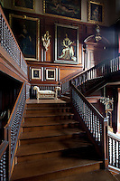 Early 18th century portraits on the panelled walls above the oak staircase, installed in 1697