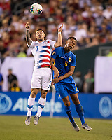 PHILADELPHIA, PA - JUNE 30: Paul Arriola #7 and Jurien Gaari #13 go up for a header during a game between Curacao and USMNT at Lincoln Financial Field on June 30, 2019 in Philadelphia, Pennsylvania.