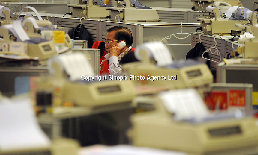 Trader at the Hong Kong Stock Exchange in Hong Kong, China. The Hong Kong Stock Exchange is Asia's third largest stock exchange in terms of market capitalization the Tokyo Stock Exchange and the Shanghai Stock Exchange and fifth largest in the world....................