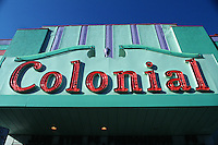An advertising marquee sign for the 'Colonial' theater.