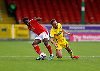 10th October 2020; The County Ground, Swindon, Wiltshire, England; English Football League One; Swindon Town versus AFC Wimbledon; Diallang Jaiyesimi of Swindon Town challenges Luke O'Neill of AFC Wimbledon