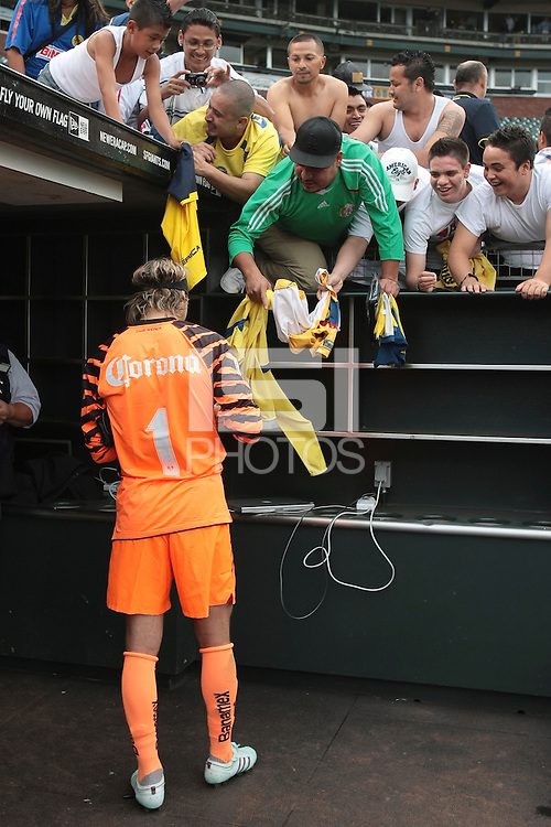 Armando Navarrete signs autographs for fans after the game. Manchester City defeated Club America 2-0 in the Herbalife World Football Challenge 2011 at AT&T Park in San Francisco, California on July 16th, 2011.