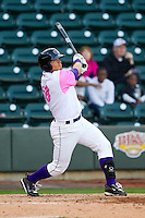 Grant Buckner (28) of the Winston-Salem Dash follows through on his swing against the Wilmington Blue Rocks at BB&T Ballpark on April 20, 2013 in Winston-Salem, North Carolina.  The Dash defeated the Blue Rocks 4-2 in game one of a double-header.  (Brian Westerholt/Four Seam Images)