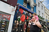 A man carries his daughter on his shoulders in Camden Town, London.
