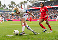 CARSON, CA - FEBRUARY 9: Julie Ertz #8 of the United States tries to keep the ball in bounds during a game between Canada and USWNT at Dignity Health Sports Park on February 9, 2020 in Carson, California.