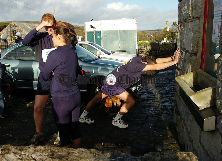 Last minute stretching and warm up exercises before the start of The Burren Charity Challenge at Carron.Pic Arthur Ellis.