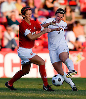 Santa Clara forward (5) Kiki Bosio fights for the ball with Maryland midfielder (12) Mallory Baker.  Maryland defeated Santa Clara, 1-0, at Ludwig Field in College Park Maryland.