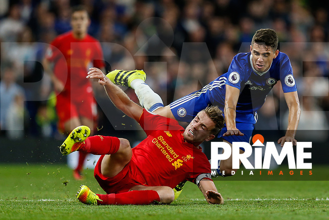 Oscar of Chelsea (right) is tackled by Jordan Henderson of Liverpool (left) during the EPL - Premier League match between Chelsea and Liverpool at Stamford Bridge, London, England on 16 September 2016. Photo by David Horn / PRiME Media Images.