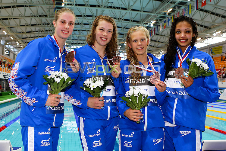 PICTURE BY ALEX WHITEHEAD/SWPIX.COM - Swimming - 2013 European Junior Swimming Championships - Termy Maltanskie, Poznan, Poland - 10/07/13 - Great Britain's 4x100m Freestyle Girls team (From left; Katie Latham, Harriet Cooper, Lucy Hope, Linda Shaw) celebrate winning Bronze.