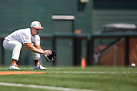 Second baseman Jordan Etier #7 of the Texas Longhorns fields a grounder against Texas Tech on April 17, 2011 at UFCU Disch-Falk Field in Austin, Texas. (Photo by Andrew Woolley / Four Seam Images)