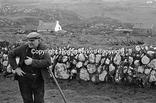 County Kerry Eire 1969,  farmer in rural landscape, a smallholding west coast Southern Ireland 1960s.