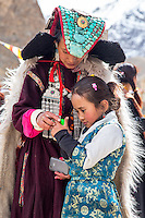 Young and old compare photos in Takmachik, Ladakh