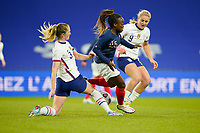 LE HAVRE, FRANCE - APRIL 13: Samantha Mewis #3 and United States team mate Lindsey Horan #9 put the squeeze on Grace Kazadi  #25 of France during a game between France and USWNT at Stade Oceane on April 13, 2021 in Le Havre, France.