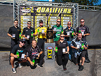 Sep 16, 2018; Mohnton, PA, USA; NHRA pro stock drivers (front row from left) Tanner Gray , Greg Anderson , Erica Enders , Chris McGaha (back row from left) Vincent Nobile , Drew Skillman , Jeg Coughlin Jr , Deric Kramer , Bo Butner and Jason Line pose for a group photo with the championship trophy after qualifying for the countdown to the championship playoffs during the Dodge Nationals at Maple Grove Raceway. Mandatory Credit: Mark J. Rebilas-USA TODAY Sports